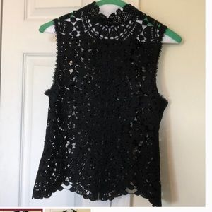 Tops - NWT. Mischievous Black top. Zippered back